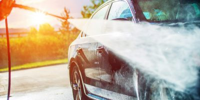 Summer Car Washing. Cleaning Car Using High Pressure Water.